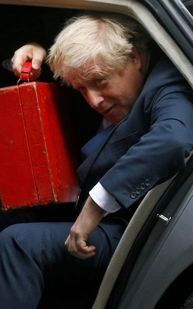 Boxed in: Prime Minister Boris Johnson arrives at Downing Street after his visit to the UN in New York. He later faced angry scenes in Parliament. Photo: Henry Nicholls/Reuters
