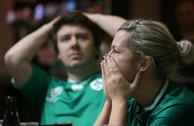 Ireland supporter, Tracey Moran and David Condon, from Sandymount watch the Ireland v Japan World Cup match in Searsons bar on Baggot Street. Photo: Damien Eagers / INM