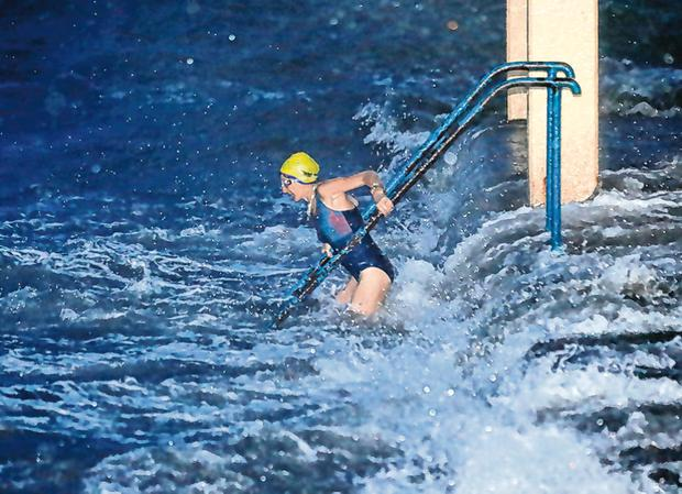 A sea swimmer takes to the water at the Blackrock Diving tower near the Promenade in Galway. Photo: Frank McGrath