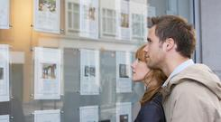 Help for first time buyers: Young couples' dream of home ownership is helped by State scheme. Picture posed