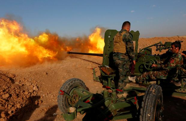 Kurdish fighters fire an anti-tank cannon at Isil forces near Mosul in Iraq in 2016