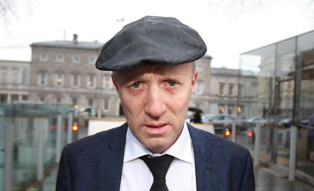In two places: Michael Healy-Rae at Leinster House. Photo: Tom Burke