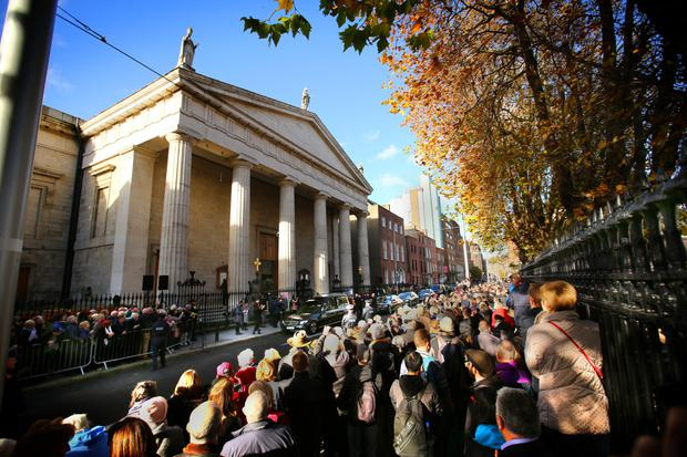 Farewell: Gay Byrne's funeral cortège outside the Pro Cathedral in Dublin yesterday. Photo: Gerry Mooney