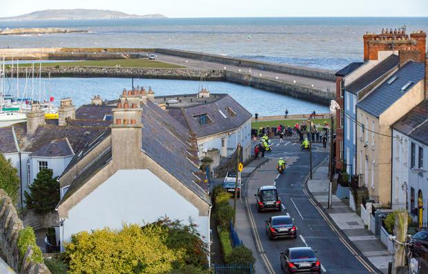 Poignant: The hearse passes through Howth; the coffin is brought to St Fintan's Cemetery. Photos: Mark Condren; Gerry Mooney; David Conachy and Colin Keegan