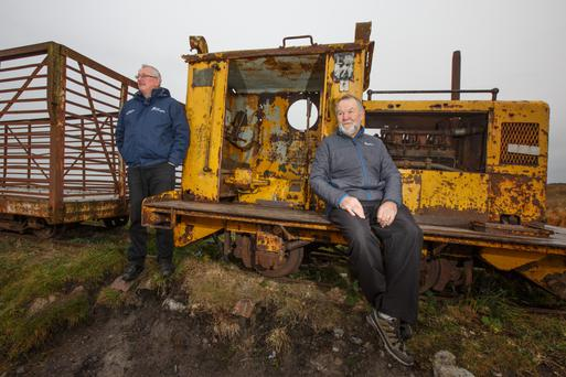 Bleak outlook: Tom Egan and Sean Craven, at Lough Boora, Co Offaly. Photo by Mark Condren