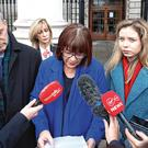 Speaking out: Mary Bennett speaks on behalf of the family outside the court as husband Pat and Aoife look on Photo: Collins