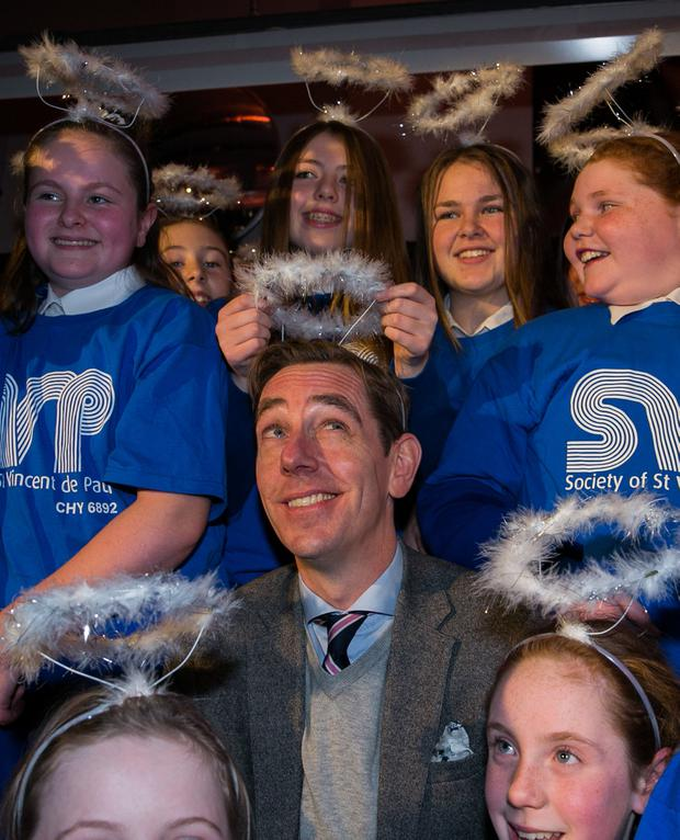 Ryan Tubridy with schoolchildren from St Josephs Primary School Tipperary during the Society of St. Vincent de Paul (SVP) Annual Appeal launch at SVP House, 91-92 Sean McDermott Street, Dublin. Photo:Gareth Chaney/Collins