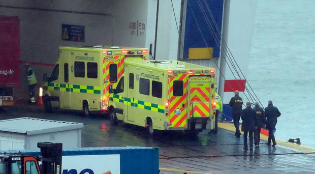 First aid: Emergency personnel at Rosslare Europort board the ferry after 16 people were discovered in a sealed trailer. Photo: Niall Carson/PA Wire