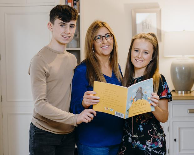 Book of hope: Sarah Corbett Lynch from Raheen, Limerick, with her brother Jack, her aunt Tracey Lynch and her first book 'Noodle Loses Dad'. Photo: Don Moloney