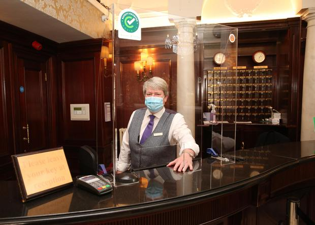Staff member Annette Kellaghan from Buswells Hotel Molesworth St Dublin 2 getting the hotel ready for its opening as hotels around the country reopen today. Photo: Gareth Chaney/Collins Photos Dublin