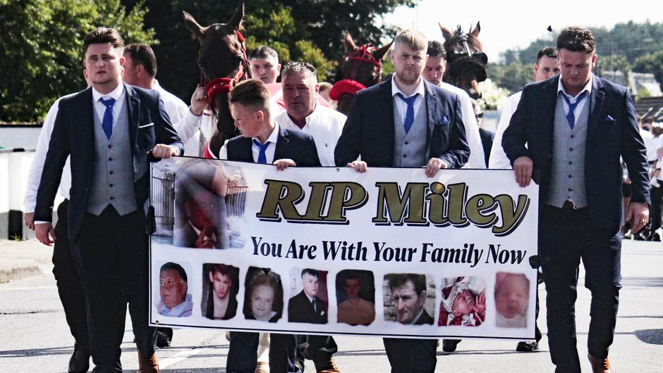 Mourners carry a banner at the funeral of Miley Harty in Askeaton, Co Limerick. Picture: Brendan Gleeson