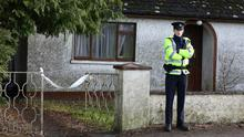 A Garda outside the home of Joseph Waters