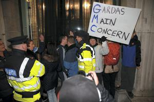 Anti-water charges protesters demonstrate outside the GPO last night. Photo: Arthur Carron