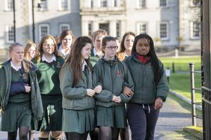 Students of St Leo's College Carlow link arms as they attend after a Mass for five past pupils involved in a car crash on Tuesday night. Picture: Mark Condren