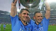 Dublin players Bernard, left and Alan Brogan lift the Sam Maguire in front of Hill 16 after victory