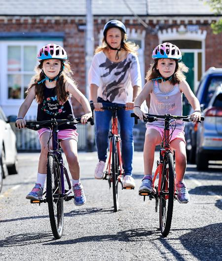 New skills: Susan Lannigan with her twin daughters Isobel and Aoileann Grant (7) who learned how to cycle with less traffic on the roads during lockdown. Photo by Gerry Mooney