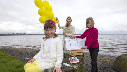 CEO of Helium Arts, Helene Hugel pictured with her children, Saoirse and Lily on the shores of Lough Ennell, Co Westmeath. Photo Brian Farrell