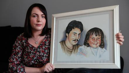 Charlene Smyth holds a painting of herself with her father Charlie McGrillen who was killed by the UFF in 1988. Photo: Brian Lawless/PA Wire