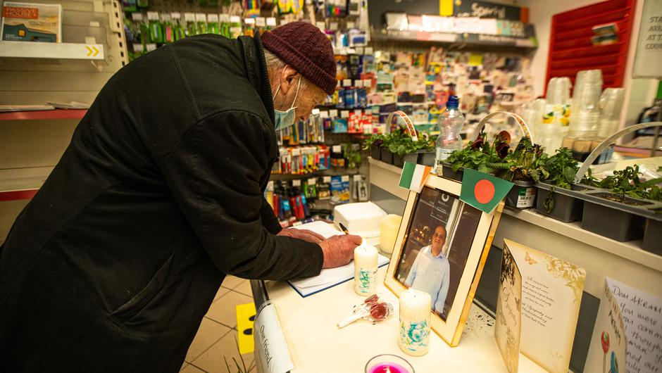 Locals leaving tributes to Centra shopkeeper Akram Hussein (Photo: Mark Condren)