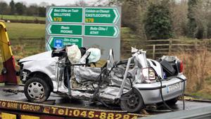 The wreckage of the car is removed from the scene of the crash. Photo: Collins