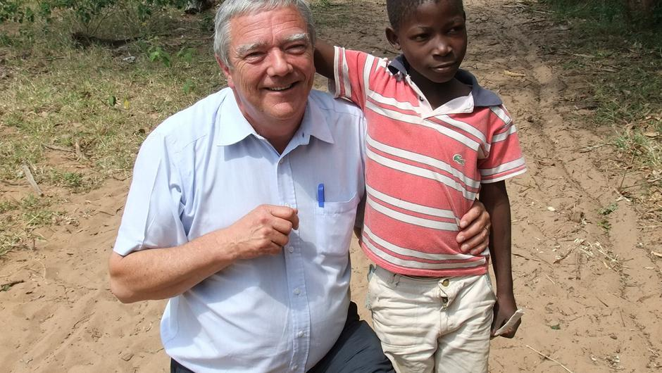 A file image of former Childfund Ireland CEO Michael Kiely with a local boy during a visit to view the charity's work in Mozambique