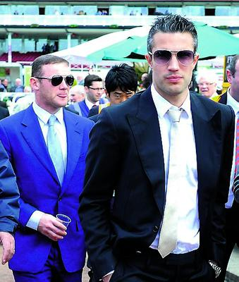 Manchester United's Robin Van Persie, Danny Welbeck and Wayne Rooney arrive at Chester Racecourse with team mates ahead of day one of the Boodles May Festival at Chester Racecourse, Chester. PRESS ASSOCIATION Photo. Picture date: Wednesday May 8, 2013. See PA story RACING Chester. Photo credit should read: Martin Rickett/PA Wire