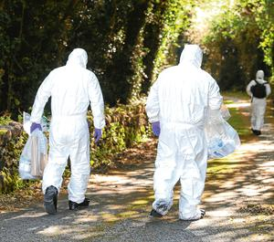 Investigation: Members of the PSNI near a laneway leading to the home of Kevin Lunney. Photo: Damien Eagers