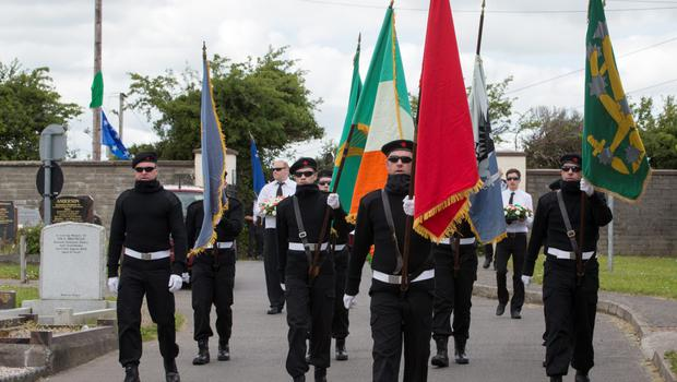 The Irish Republican Socialist Party gather with full military to  march to Bornabreena cemetery in Commemorating John Morris who was a former member of the INLA
