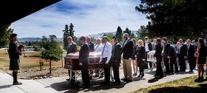 A HAUNTING LAMENT: The cortege halts as a lone piper plays 'She Moved Through The Fair' as the coffins of Ashley Donohoe and Olivia Burke, cousins and best friends, were brought yesterday into the Church of St Joseph's in Cotati, Sonoma County, California