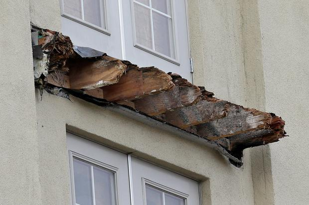 The remains of the balcony at the Library Gardens apartment complex showing the degraded timber beams