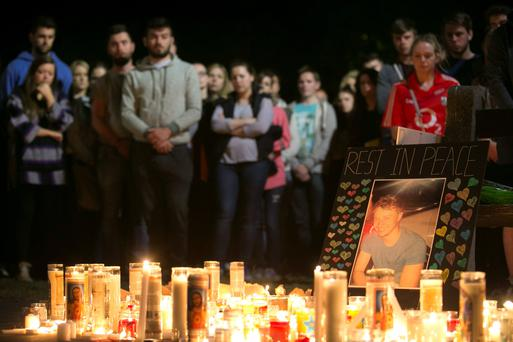 A picture of Niccolai Schuster is placed at a memorial during a vigil on Wednesday for the victims of the Berkeley balcony collapse