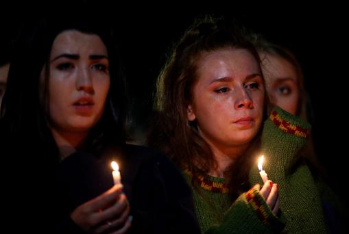 Students hold candles as they gather at the Martin Luther King Jr Civic Center Park to mourn the victims of the Berkeley balcony tragedy