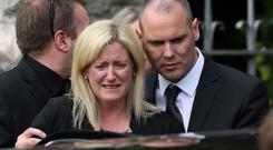 Lorcán Miller's parents Sinéad and Ken at their son's funeral Mass at Rathmichael Church in Shankill, Dublin, yesterday