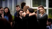 GRIEF: Students, friends and relatives of the six students who died in Berkeley, California, gather at a memorial service held in UCD, Belfield, last Friday. Photo: David Conachy