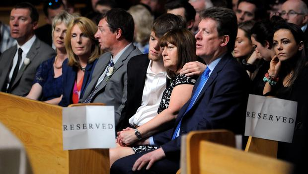 The Burke family (from right), father Paul, mother Paula and brother Gavin at the funeral service at the weekend for cousins Olivia Burke and Ashley Donohoe