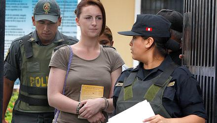 Michaella McCollum, handcuffed, arrives for a court hearing in Lima, Peru on December 17, 2013. McCollum and Melissa Reid were detained earlier that year at Lima airport for allegedly trying to smuggle cocaine on to a flight to Spain. They were formally charged with drug trafficking. Photo: AP Photo/Karel Navarro