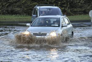 A Motorist makes his  way through flood waters at Littlepace, Clonee. Photo: Frank McGrath