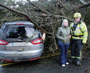 Colette Brennan at her car with fireman John Ging