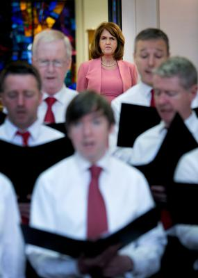 TIME TO SING FROM THE SAME HYMN SHEET: Tanaiste Joan Burton TD with the Department of An Taoiseach staff choir during the annual lunchtime recital of Christmas carols at Government Buildings, Dublin. Photo: Gareth Chaney Collins