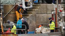 Wreckage from the helicopter is brought back to Blacksod Pier Photo: Steve Humphreys