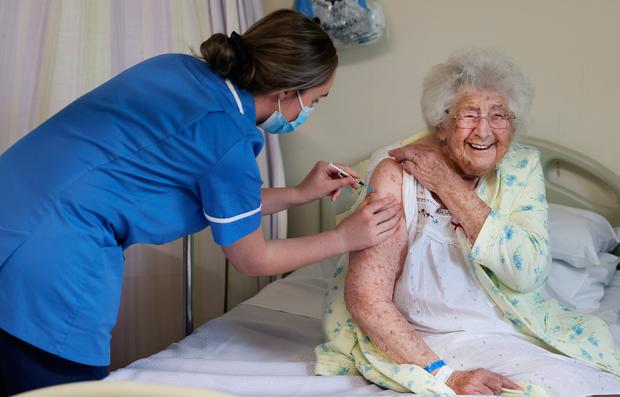 Ethel Murdoch (95) from Liverpool receives her coronavirus vaccine at Aintree University Hospital as the rollout continued across the UK. Photo: Gareth Jones/PA