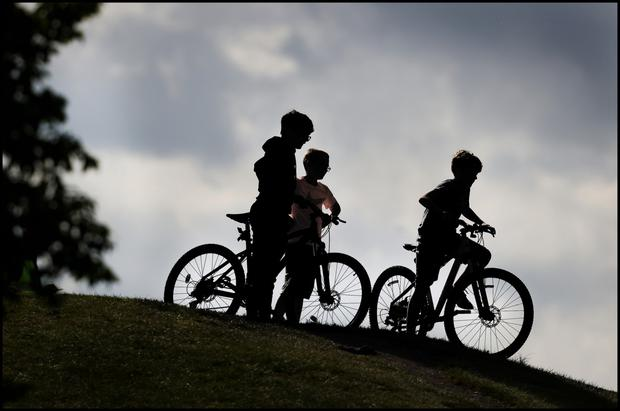 Three young boys take to the hills on their bikes in the Phoenix Park. Photo by Steve Humphreys