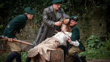 Hacked off: Black and Tans forcibly cut the hair of Sineád (Orla Fitzgerald) in a scene from The Wind That Shakes The Barley. Courtesy: Joss Barratt/Sixteen films