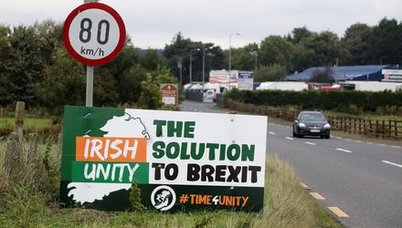 A billboard presents a solution to the problems that have emerged from Brexit. Photo: Paul Faith/AFP via Getty.