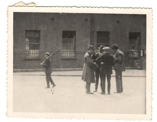 Todd Andrews (extreme right) conversing with fellow anti-Treaty IRA men Seán MacBride, Andy Cooney and Ernie O'Malley inside the Four Courts in 1922
