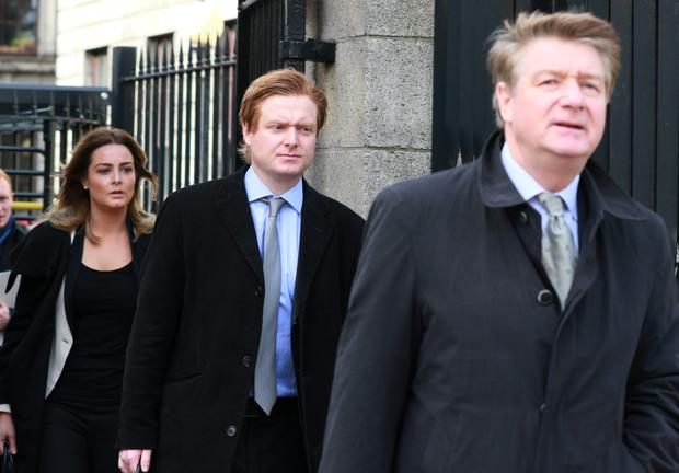 Brian O Donnell leaving Four Courts on a previous occasion with two of his children, Blake (centre) and Blaise (left). Photo: Courts Collins