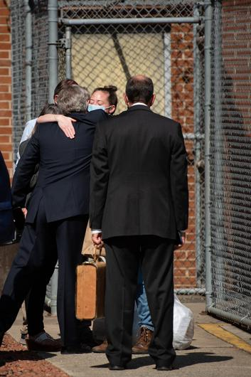 Molly Martens Corbett is embraced after walking out of the Davidson County Courthouse on Wednesday.