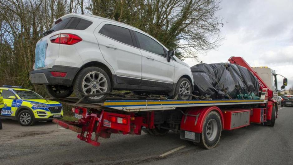 The Ford EcoSport owned by Mary O'Keeffe and shell of the Dacia Duster SUV are removed from the scene of the tragedy at Dromdeer in February