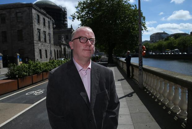 Dominic Casey pictured leaving the High Court in Dublin following a settlement in a case over the death of his wife at Cork University Maternity Hospital Picture: Collins Courts