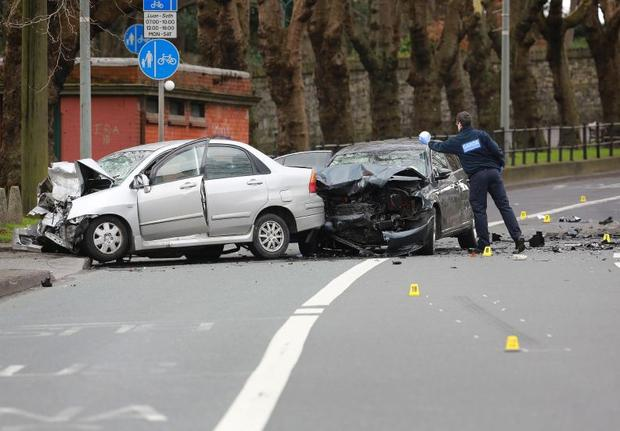 A garda at the scene of the fatal car crash on the Drumcondra Road
